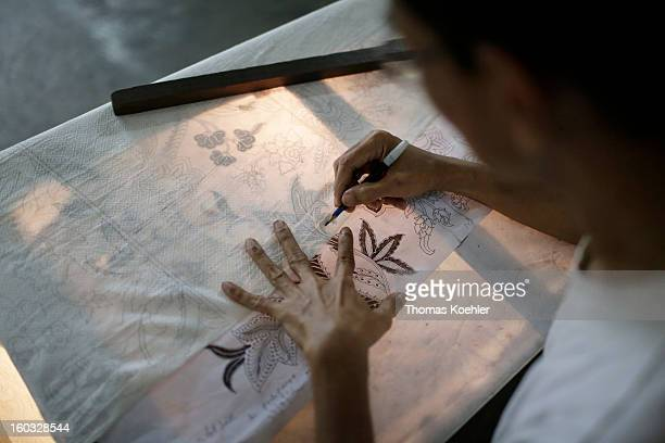 At the Danar Hadi batik production company where the monthly wage is around 90 euros and it can take up to five months to complete a complicated...