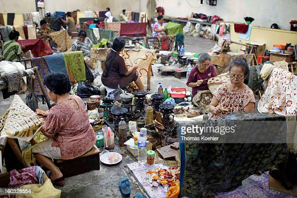 At the Danar Hadi batik production company where the monthly wage is around 90 euros and it can take up to five months to complete a bolt of fabric...