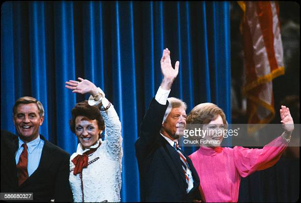 At the Democratic National Convention the party's nominees and their wives wave from the stage New York New York August 1980 Pictured are from left...