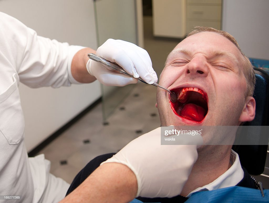 at the dentist - blutiger Horror Zahnarztbesuch : Stock Photo