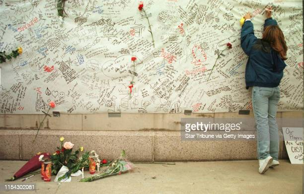 At the Denver Civic Center Amphitheater at a candlelight vigil for victims of the Columbine HS shootings Tamara Tatar writes her sentiments on a...