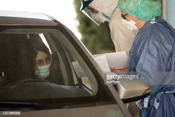 At the Department of Public Health in San Lazzaro Bologna medical staff perform the coronavirus screening test on patients directly in the car on...