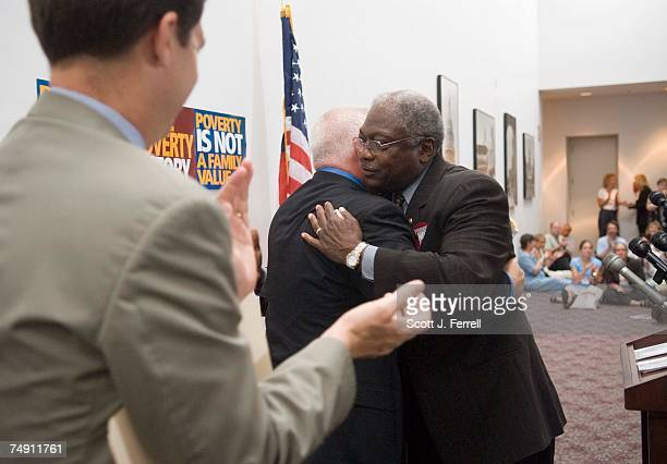 At the Dirksen Senate Office Building at the US Capitol House Democratic Caucus Chairman James E Clyburn DSC gets a hug from Sojourners Executive...