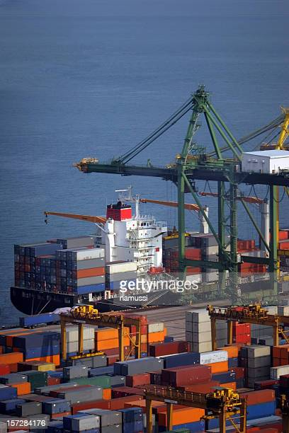 At the dock: containers and ship, just in time