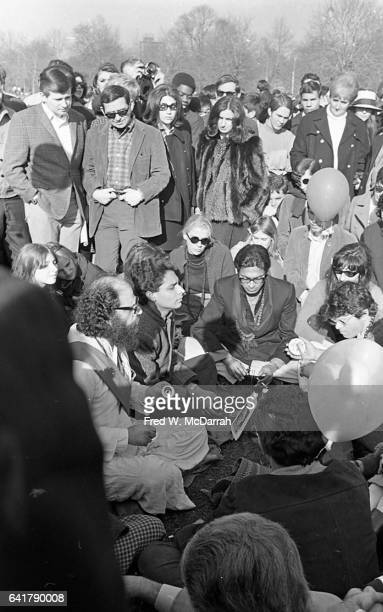 At the 'Easter BeIn' on Central Park's Sheep Meadow American poet Allen Ginsberg and Gregory Corso face one another New York New York March 26 1967