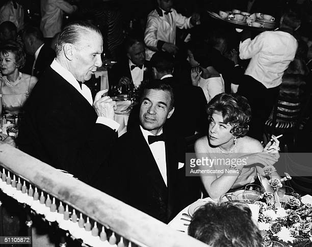 At the El Morocco restraurant owner John Perona describes some of the menu items to Dominican diplomat and socialite Porfirio Rubirosa and Mrs Serge...