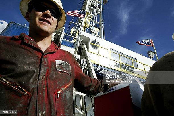 At the end of a 12hour shift roughnecks take an elevator to the ground of a natural gas drilling rig May 8 2004 eight miles north of Evanston Wyoming...