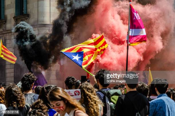At the end of the demonstration black and red smoke was seen among the demonstrators with independence flags Thousands of Catalan university students...