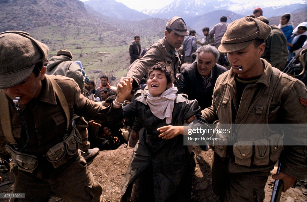 Turkey - Kurdish Refugees - A desperate woman is led away by Turkish soldiers : News Photo