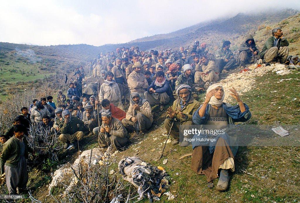 Turkey - Kurdish Refugees - Kurdish refugees being held back by Turkish soldiers : News Photo