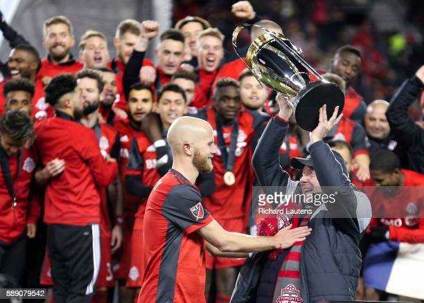 TORONTO ON DECEMBER 9 At the end of the game MLSE chair Larry Tanenbaum hoists the cup with captain Michael Bradley The TFC beat the Seattle Sounders...