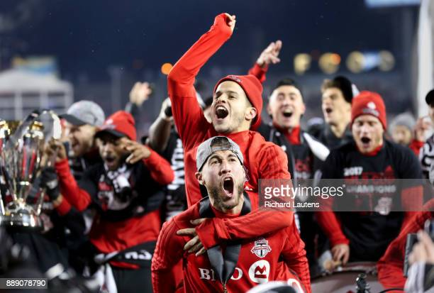 TORONTO ON DECEMBER 9 At the end of the game Toronto FC midfielder Jonathan Osorio hoists Toronto FC forward Sebastian Giovinco on his back as they...