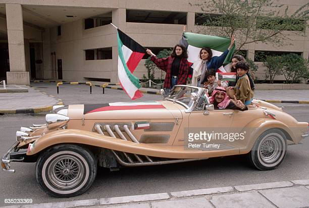 At the end of the Gulf War Kuwaitis take to the streets to celebrate their country's liberation from Iraq