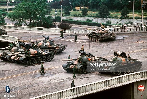 At the end of the prodemocracy movement in China a group of Chinese Army tanks block an overpass on Changan Avenue leading to Tiananmen Square where...