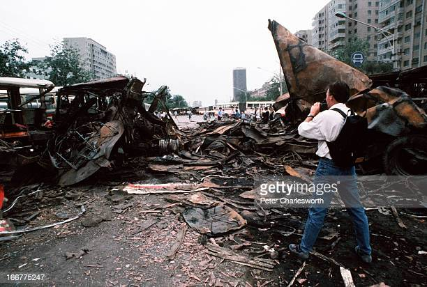 At the end of the prodemocracy movement in China an American news cameraman films a scene of destroyed buses that had been barricades run over by...