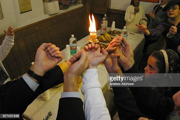 At the end of the Purim festival and 18 minutes before the beginning of Shabbat the candles are lit in the synagogue and everyone puts their hands...