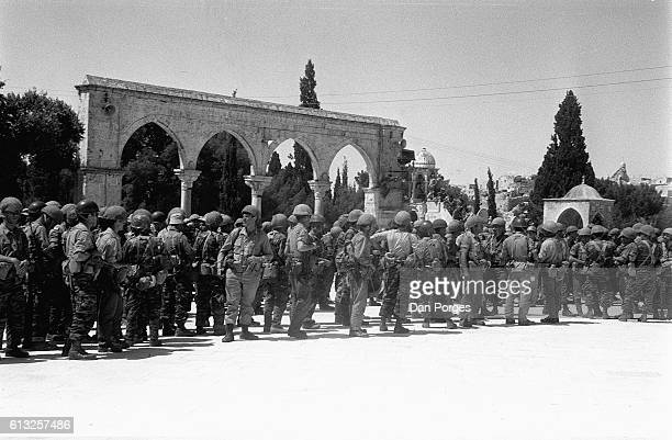 At the end of the Six Day War Israeli paratroopers gather on the Temple Mount Old City of Jerusalem Israel June 11 1967 Israeli forces defeated the...