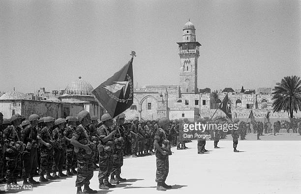 At the end of the Six Day War Israeli paratroopers stand to attention on the Temple Mount Old City of Jerusalem Israel June 11 1967 Israeli forces...