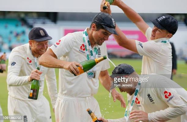 At the England post match celebrations Alastair Cook is doused with champagne by Sam Curran during the 5th day of the England v India 5th test match...