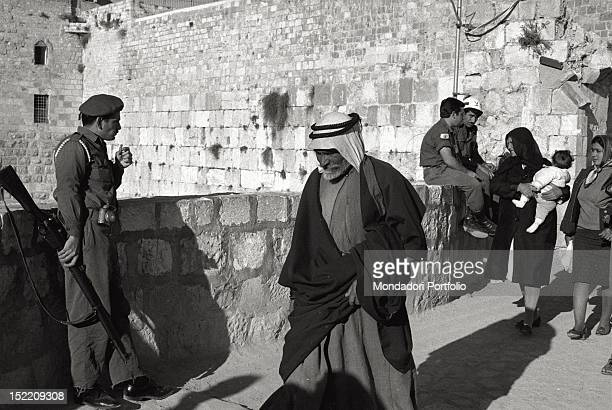 At the entrance of the sacred Islamic site in the Old City in Jerusalem where there is the AlAqsa Mosque and the Dome of the Rock armed Israeli...