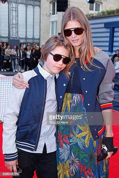 at the evening gala by Tommy Hilfiger who organized the match Football/Tennis Malgosia Bela with her son Jozef are photographed for Paris Match on...