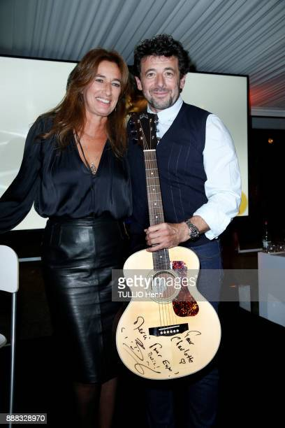 at the evening gala for the association Zazakely Sambatra at the Pre Catelan Patrick Bruel and Berengere Courtois are photographed for Paris Match on...