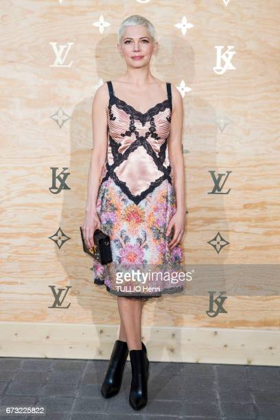 at the evening gala for the new collection Masters of louis Vuitton by Jeff Koons Michelle Williams poses for Paris Match on april 11 2017 in Paris...