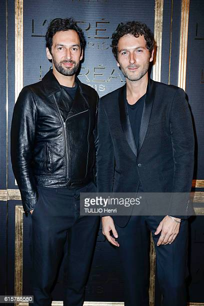 at the evening gala for the new makeup line Gold Obsession by L'Oreal Simon Buret and Olivier Coursier of the Group Aaron pose for Paris Match on...