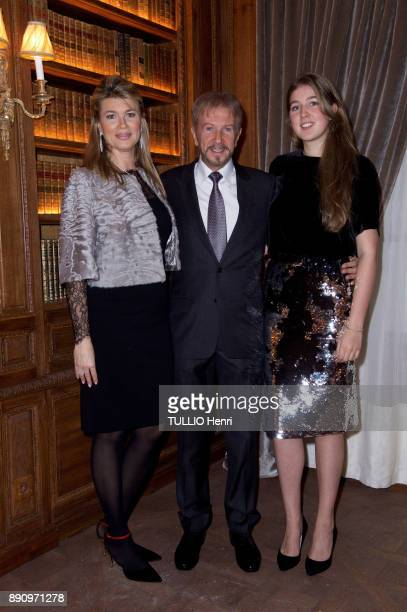 at the evening gala for the opening the Cafe Pouchkine Andrei Dellos with his wife Jenie and his daugther Katia are photographed for Paris Match at...