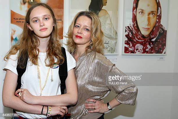 at the evening gala of the exhibition 55 Politiques by the photographer Stéphanie Murat Lily Taieb and her mother laure Marsac pose on june 09 2016...