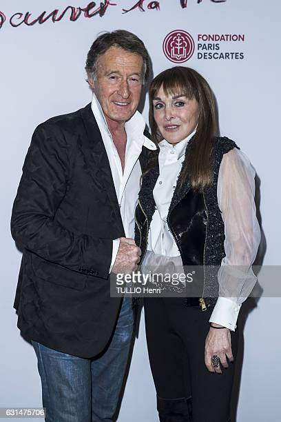at the evening gala Sauver la vie of the Foundation Paris Descartes Eric Pfrunder and Babeth Djian pose for Paris Match on november 30 2016 in Paris...