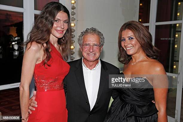 at the evening of the Foundation Care France in Deauville Casino Laurent Dassault Andrea Dibelius and Asmae Azizi pose on august 29 2015 in Deauville...
