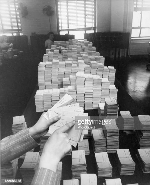 At the Federal Bureau of Investigation headquarters an employee points to identification index cards that denotes a person as 'noncriminal'...