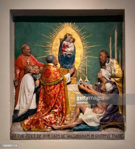 at the feet of our lady of walsingham plaque at the shrine - jesus birth stock pictures, royalty-free photos & images