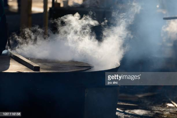 at the festival, i am making big broth with big iron pot. - hot spring stock pictures, royalty-free photos & images