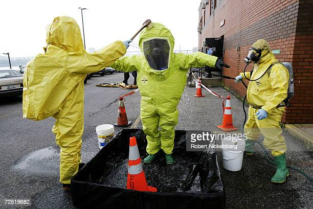 At the Fire Department of New York training facility firemen go through a simulated toxic chemical spill May 13 2004 on Randalls Island New York City...