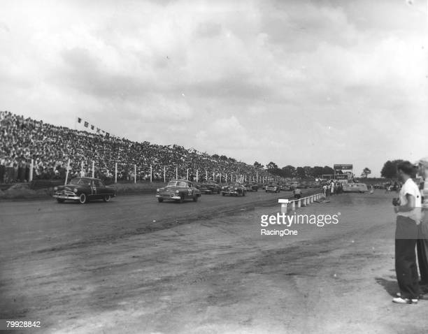 At the first ever NASCAR Strictly Stock race Otis Martin leads Red Byron Jim Roper became eventual winner of the affair on June 19 1949 in Charlotte...