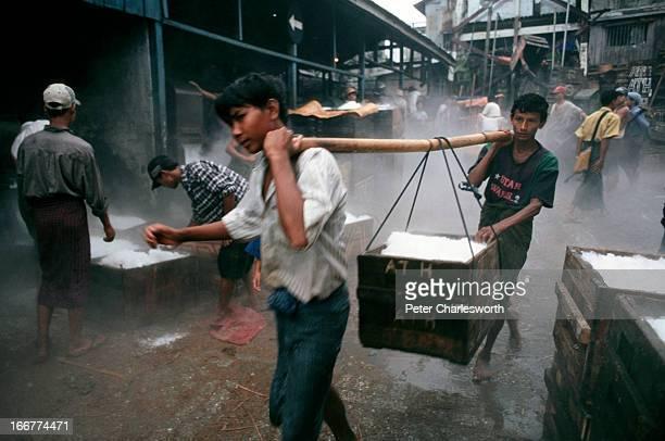 BURMA YANGON RANGOON MYANMAR At the Fish Market on the banks of the Yangon river in Rangoon ice vendors prepare crates of crushed ice for the fish