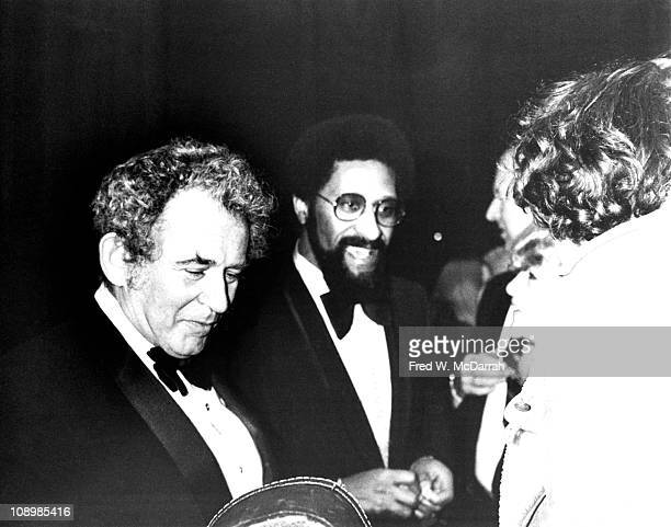 At the Four Seasons restaurant for his 50th birthday party American author and journalist Norman Mailer talks with his guests New York New York...