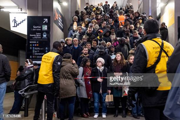 At the Gare du Nord station, on the platforms of RER B, security agents are keeping passengers waiting on the stairs and upper floors to avoid crowd...