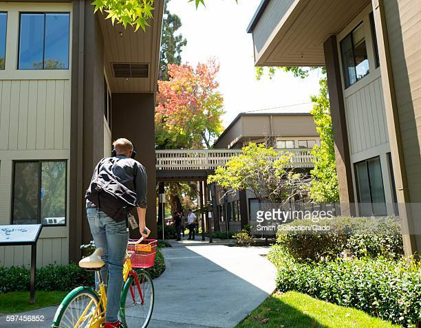 At the Googleplex headquarters of the search engine company Google in the Silicon Valley town of Mountain View California a Google employee rides a...