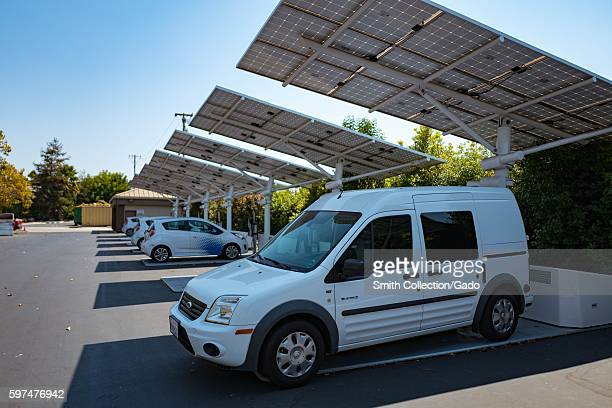 At the Googleplex headquarters of the search engine company Google in the Silicon Valley town of Mountain View California a small electric van is...