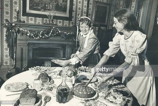 At the groaning board in Mackenzie House this week Jenny Bull right and Pat Lochhead lay out a Christmas repast In Victorian Toronto on Christmas Day...