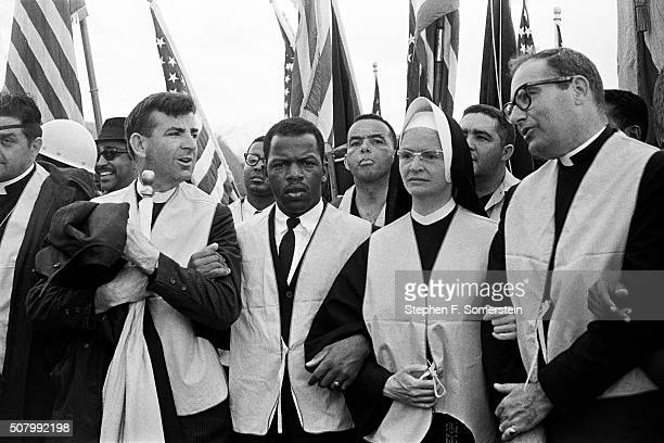 At the head of the march nuns priests and civil rights leaders leave from the City of St Jude school grounds LR Rev Dominic T Dom Orsini priest with...