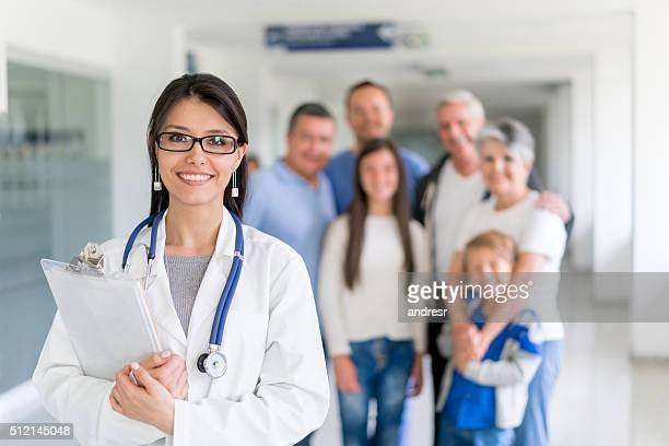 GP at the hospital with a group of patients