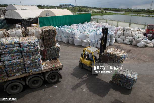 At the Indorama Ventures factory flattened plastic bottles bottlesmoved into the factory for processing on August 4 2017 in Nakon Pathom Thailand...
