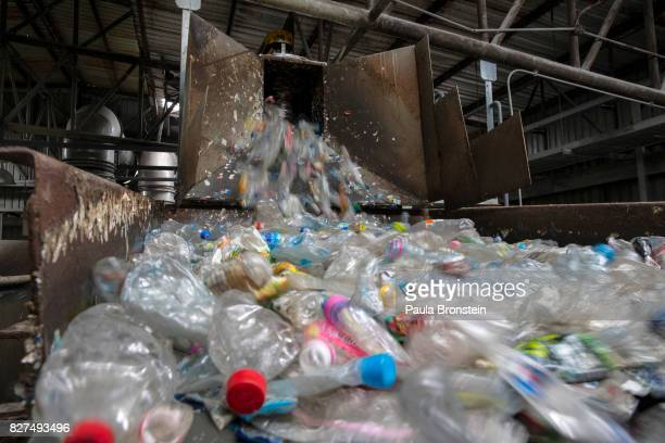 At the Indorama Ventures factory flattened plastic bottles that have been steam cleaned move along on a conveyer belt for processing on August 4 2017...