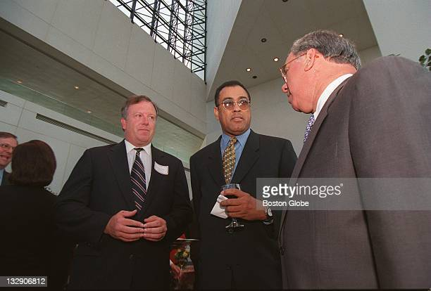 At the John F Kennedy Library Boston City Councilman Stephen Murphy left listens as Ben Jeffers Chairman of the Louisiana Democratic Party center...