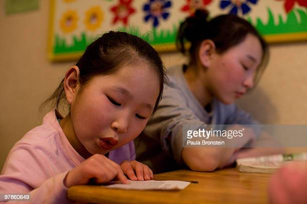 At the Lighthouse girls shelter Mongolian girls do their homework after coming back from school March 10 2010 in Ulaan Baatar Mongolia The police...