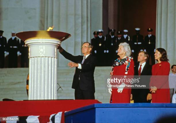 At the Lincoln Memorial US PresidentElect George HW Bush lights a ceremonial flame during his inaugural opening ceremony Washington DC January 18...